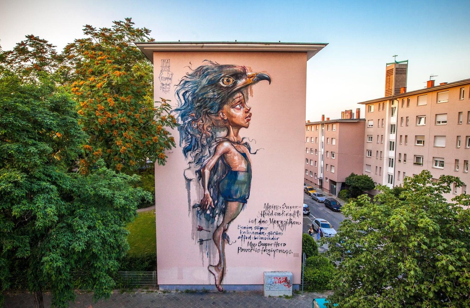 Openluchtkunst van Herakut in Mannheim